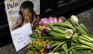 A bouquet of flowers and a magazine showing Maya Angelou on the cover lies outside a gate at the home of Angelou in Winston-Salem, N.C., Wednesday, May 28, 2014. Angelou, a Renaissance woman and cultural pioneer, has died, Wake Forest University said in a statement Wednesday. She was 86. (AP Photo/Gerry Broome)