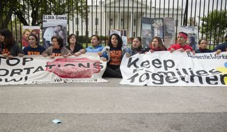FILE - This April 28, 2014 file photo shows demonstrators sitting on the sidewalk outside the White House in Washington during a demonstrations to demand President Barack Obama stop deportation of immigrants. Republicans standing between President Barack Obama and an immigration overhaul say the president's move to ease deportations is Exhibit A for why Obama can't be trusted to enforce the law. So Obama is moving to deny Republicans that argument, setting up the GOP to bear all the blame if summer comes and goes with no action on immigration.. (AP Photo, File)