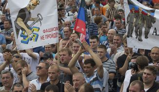 "Miners rally in Donetsk, Ukraine, on Wednesday, May 28, 2014. Coalminers in the Donbass coalfields have gone on an open-ended strike to demand Ukrainian troops and other forces leave the Donetsk Region, the first deputy coal minister of the self-proclaimed Donetsk People's Republic, Konstantin Kuzmin, has told ITAR-TASS. Poster reads ""No to Fascism!' (AP Photo/Ivan Sekretarev)"