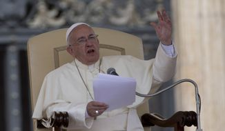 Pope Francis delivers his speech during the weekly general audience he held in St. Peter's Square, at the Vatican,  Wednesday, May 28, 2014. (AP Photo/Andrew Medichini)