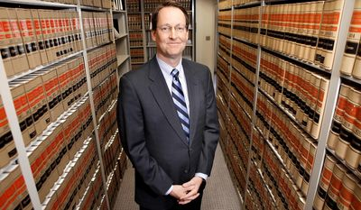 FILE - This April 19, 2010 file photo shows U.S. District Judge William Conley at the U.S. Courthouse in Madison, Wis. An unusual courtroom discussion between three doctors in a federal trial dealing with Wisconsin's requirement that abortion providers have hospital admitting privileges got off to a rocky start Thursday, May 29, 2014, with Judge Conley sparring verbally with one expert. (AP Photo/Mike DeVries, The Capital Times, File)