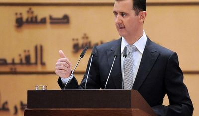 Syrian President Bashar Assad, in a speech Tuesday at Damascus University, said he would not step down and insisted that he still has his people's support despite a 10-month-old uprising against him. (SANA via Associated Press)