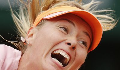 Russia's Maria Sharapova serves the ball to Bulgaria's Tsvetana Pironkova during the second round match of  the French Open tennis tournament at the Roland Garros stadium, in Paris, France, Wednesday, May 28, 2014. (AP Photo/David Vincent)