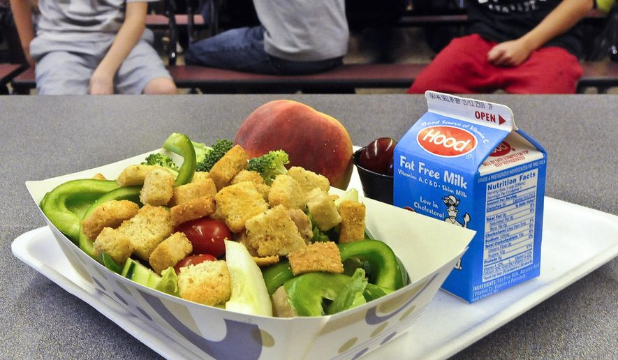 FILE - This Sept. 11, 2012 file photo shows a healthy chicken salad school lunch, prepared under federal guidelines, sitting on display at the cafeteria at Draper Middle School in Rotterdam, N.Y. A House committee has endorsed a GOP plan to allow some schools to opt out of healthier school meal standards. The vote comes as First Lady Michelle Obama has launched a campaign in support of the standards, holding a White House meeting this week. (AP Photo/Hans Pennink, File)