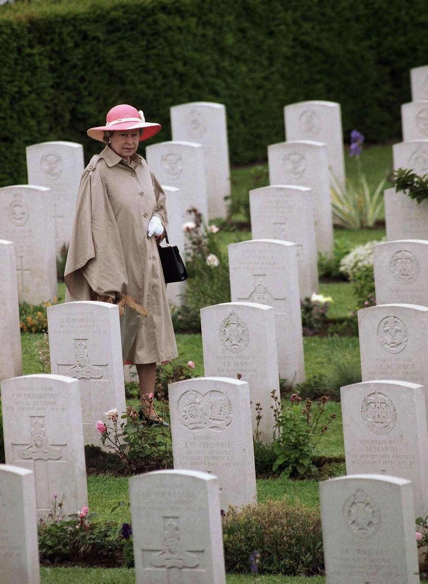 FILE - In this Monday, June 6, 1994 file photo, Queen Elizabeth II is seen walking through the British Military Cemetery in Bayeux, France, during ceremonies honoring veterans and war dead on the 50th anniversary of D-Day. Queen Elizabeth II and her husband Prince Philip have for the most part stopped traveling overseas _ a reluctant concession to their advancing years _ but they are scrapping this policy next week for the 70th commemoration of the momentous D-Day invasion on June 6, 2014. The perils of World War II directly shaped the lives of Elizabeth, 88, and Philip, 92. The anniversary is so heartfelt that the royal couple is preparing to cross the English Channel once more, this time on a Eurostar train through the Channel Tunnel Elizabeth helped 20 years ago.  (AP Photo/Laurent Rebours, File)