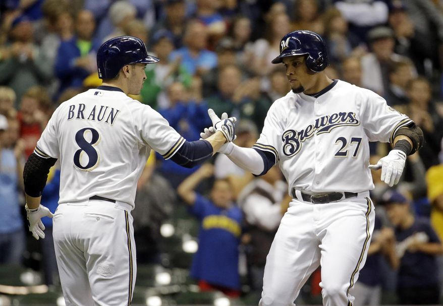 Milwaukee Brewers' Carlos Gomez (27) is congratulated by Ryan Braun after hitting a three-run home run off Baltimore Orioles starting pitcher Wei-Yin Chen during the first inning of a baseball game Tuesday, May 27, 2014, in Milwaukee. (AP Photo/Morry Gash)