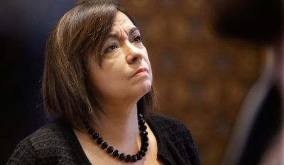 Illinois Sen. Iris Martinez, D-Chicago, watches the vote tote board while on the Senate floor during session at the Illinois State Capitol Thursday, May  29, 2014, in Springfield Ill. (AP Photo/Seth Perlman)