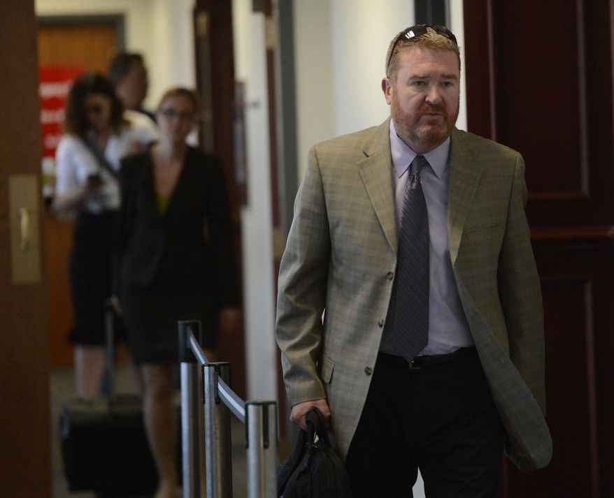 Defense attorney for James Holmes, Daniel King, leaves the courtroom at the Arapahoe County Justice Center after a motion hearing involving particular procedures during jury selection at the Arapahoe County Justice Center, Thursday, May 29, 2014, in Centennial, Colo. Holmes pleaded not guilty by reason of insanity to charges of killing 12 people and injuring 70 in the July 2012 attack. Prosecutors are seeking the death penalty. Jury selection is scheduled to start in October, and the judge has said it could take up to three months. (AP Photo/The Denver Post, Andy Cross, Pool)