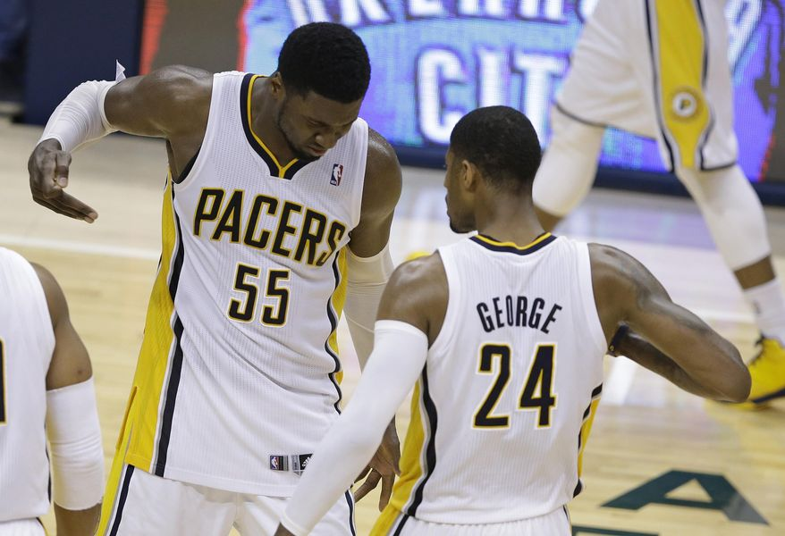 Indiana Pacers' Roy Hibbert and Paul George celebrate after George hit a shot as time expired to end the third quarter of Game 5 of the Eastern Conference finals NBA basketball playoff series against the Miami Heat on Wednesday, May 28, 2014, in Indianapolis. (AP Photo/Darron Cummings)