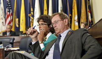 Rep. Paul Cook, R-Calif., right, and Rep. Jackie Walorski, R-Ind., members of the House Committee on Veterans' Affairs, listen as officials from the Department of Veterans Affairs testify about allegations of gross mismanagement and misconduct at Veterans Administration hospitals, possibly leading to patient deaths, on Capitol Hill in Washington, Wednesday, May 28, 2014. (AP Photo/J. Scott Applewhite) ** FILE **