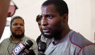 FILE - In this Aug. 3, 2012 file photo, Washington Redskins safety Tanard Jackson speaks during a media availability at Redskins Park in Ashburn, Va. Jackson worked a 9-to-5 job in a warehouse to support his family during his latest NFL drug suspension. Now the safety is back for what is likely his last chance with the Redskins. (AP Photo/Alex Brandon, File)