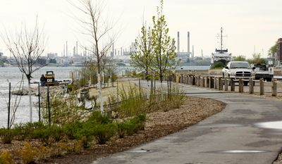 In this photo taken on Tuesday, May 20, 2014, improvements are being finalized along the the south portion of the River Walk along the St. Clair River in Port Huron, Mich. A grand opening for the River Walk will be on June 7. (AP Photo/The Port Huron Times Herald, Jeffrey Smith)  NO SALES