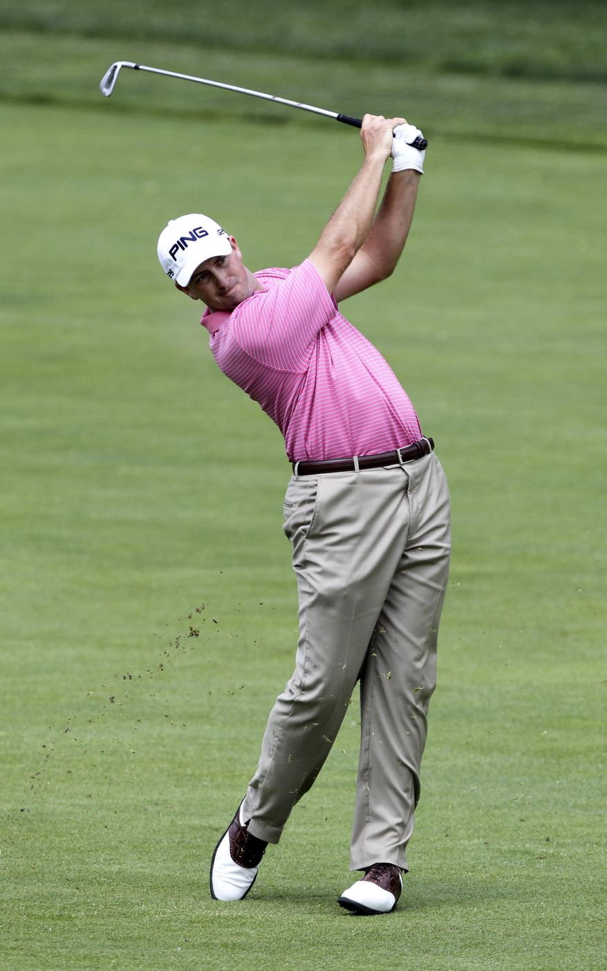 Michael Thompson hits his approach shot on the 18th hole during the first round of the Memorial golf tournament Thursday, May 29, 2014, in Dublin, Ohio. (AP Photo/Jay LaPrete)