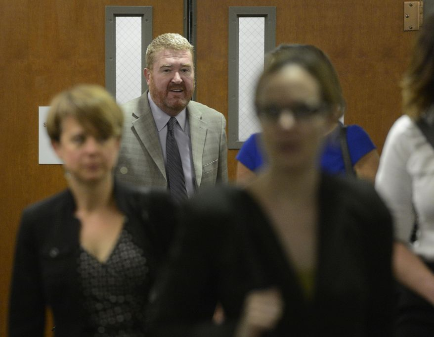 Daniel King, defense attorney for James Holmes, arrives at the Arapahoe County Justice Center for a hearing on Thursday, May 29, 2014 in Centennial, Colo.  The hearing will focus on how prospective jurors should be interviewed and what they should be asked in a written questionnaire. James Holmes pleaded not guilty by reason of insanity to charges of killing 12 people and injuring 70 in the July 2012 attack. Prosecutors are seeking the death penalty. Jury selection is scheduled to start in October, and the judge has said it could take up to three months.  (AP Photo/The Denver Post, Andy Cross, Pool)