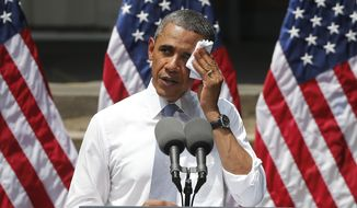 FILE - This June 25, 2013 file photo shows President Barack Obama wiping perspiration from his face as he speaks about climate change at Georgetown University in Washington. The Obama administration is poised to unveil first-ever rules limiting greenhouse gas emissions from the power plants that dot the U.S. map. President Barack Obama says the rules are essential to curb climate change, but critics disagree.  (AP Photo/Charles Dharapak, File)