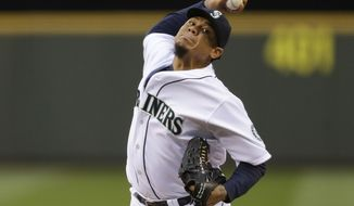 Seattle Mariners starting pitcher Felix Hernandez throws in the fourth inning of a baseball game against the Los Angeles Angels, Wednesday, May 28, 2014, in Seattle. (AP Photo/Ted S. Warren)