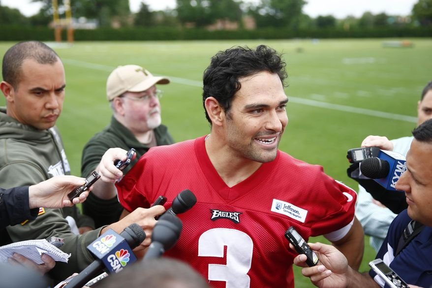 Philadelphia Eagles quarterback Mark Sanchez speaks with members of the media after an NFL football organized team activity Thursday, May 29, 2014, in Philadelphia. (AP Photo/Matt Rourke)