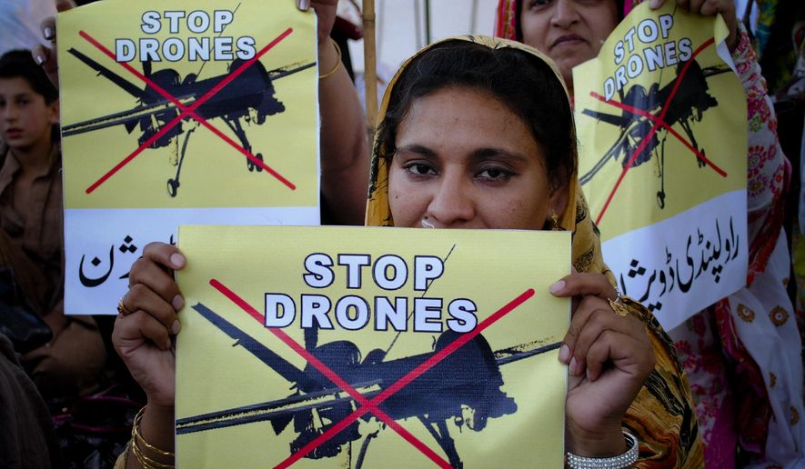 Pakistan women take part in a rally against the U.S. drone strikes in Pakistani tribal areas in Peshawar, Pakistan, in this April 23, 2011, file photo. (AP Photo/Mohammad Sajjad, file)