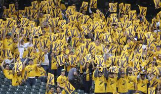 "Fans in the special ""King's Court"" section hold up ""K cards"" as they cheer for Seattle Mariners starting pitcher Felix Hernandez to get a strikeout in the fourth inning of a baseball game against the Los Angeles Angels, Wednesday, May 28, 2014, in Seattle. (AP Photo/Ted S. Warren)"