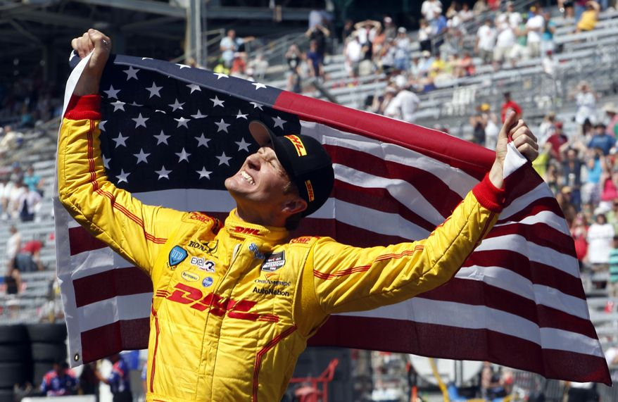 10ThingstoSeeSports - Ryan Hunter-Reay celebrates after winning the 98th running of the Indianapolis 500 IndyCar auto race at the Indianapolis Motor Speedway in Indianapolis, Sunday, May 25, 2014. (AP Photo/Tom Strattman, File)