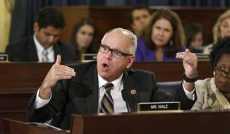 Rep. Tim Walz, D-Minn., a member of the House Committee on Veterans' Affairs, questions witnesses from the Department of Veterans Affairs as the panel investigates allegations of gross mismanagement and misconduct at VA hospitals possibly leading to patient deaths, on Capitol Hill in Washington, Wednesday, May 28, 2014. (AP Photo/J. Scott Applewhite) **FILE**