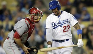 Los Angeles Dodgers' Matt Kemp, right, reacts after striking out while standing next to Cincinnati Reds catcher Devin Mesoraco during the ninth inning of a baseball game on Wednesday, May 28, 2014, in Los Angeles. The Reds won 3-2. (AP Photo/Jae C. Hong)