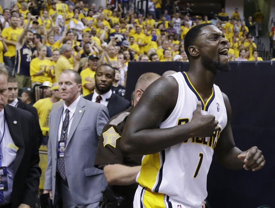 Indiana Pacers guard Lance Stephenson (1) returns to the floor against the Miami Heat during the second half of Game 5 of the NBA basketball Eastern Conference finals in Indianapolis, Wednesday, May 28, 2014. (AP Photo/Michael Conroy)