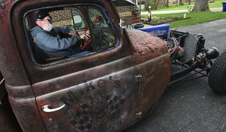 """ADVANCE FOR USE SUNDAY, JUNE 1 AND THEREAFTER - In this April 30, 2014 photo, Mike Foran, of Decatur, Ill., sits in his """"Rat Rod"""" that he pieced together using a series of unique components. Foran enjoys showing the novelty vehicle at car shows. (AP Photo/Herald & Review, Jim Bowling)"""