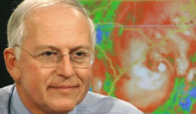 FILE - In this Aug. 31, 2006 file photo, National Hurricane Center director Max Mayfield briefs a Charleston, S.C., television audience on the progress of Tropical Storm Ernesto, at the hurricane center in Miami. Delivering the weather has put a whole new group of celebrities on the national radar: meteorologists. Mayfield, the retired director of the National Hurricane Center in Miami, became an accidental TV personality following Hurricane Katrina in 2005. (AP Photo/Andy Newman, File)