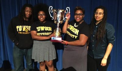 Cross Examination Debate Association national champions Ameena Ruffin (second from left) and Korey Johnson (second from right) of Towson University, with coaches Ignacio Evans (far left) and Amber Kelsie (far right).