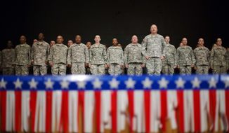 Soldiers with the Georgia National Guard 876th Vertical EN Company stand during a departure ceremony before the unit deploys to Afghanistan, Thursday, May 29, 2014, in Toccoa, Ga. Officials say the group from Toccoa will be deployed with nearly 150 guardsmen. (AP Photo/David Goldman)