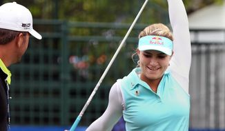 Lexi Thompson stretches on the first tee during a pro-am for the Shoprite Classic golf tournament in Galloway, N.J., , Thursday, May 29, 2013. (AP Photo/The Press of Atlantic City, Michael Ein) MANDATORY CREDIT