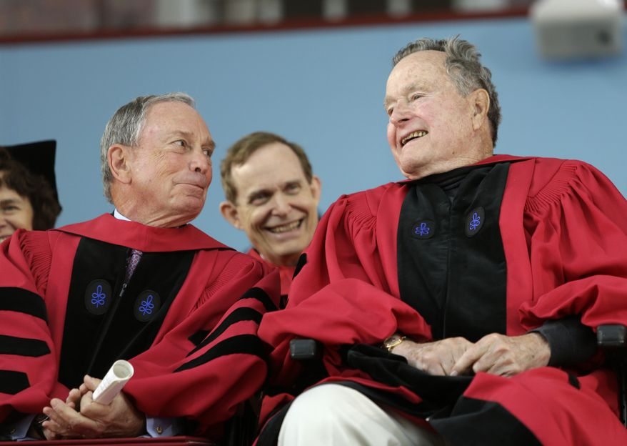 Former New York City Mayor Michael Bloomberg, left, speaks with former President George H. W. Bush, right, during Harvard commencement ceremonies, Thursday, May 29, 2014, in Cambridge, Mass. Both were presented with honorary degrees during the ceremonies. (AP Photo/Steven Senne)