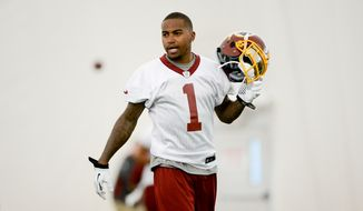 Washington Redskins wide receiver DeSean Jackson (1) watches practice as the Washington Redskins hold their Organized Team Activities, Ashburn, Va., Thursday, May 29, 2014. (Andrew Harnik/The Washington Times)