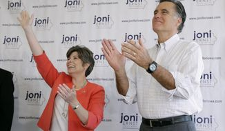 Former Republican presidential nominee Mitt Romney greets supporters before speaking at a rally for Iowa Republican Senate candidate Joni Ernst, left, Friday, May 30, 2014, in Cedar Rapids, Iowa. (AP Photo/Charlie Neibergall)