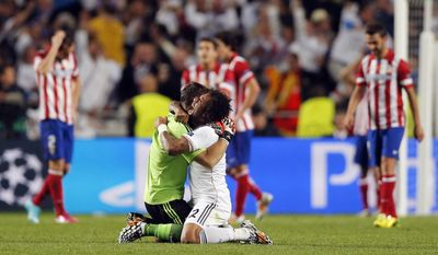 10ThingstoSeeSports - Real Madrid's Marcelo, center right, and goalkeeper Iker Casillas celebrate during the Champions League final soccer match against Atletico Madrid at the Luz stadium in Lisbon, Portugal, Saturday, May 24, 2014. (AP Photo/Daniel Ochoa de Olza, File)