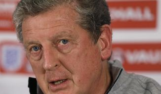 England's soccer team manager Roy Hodgson listens at a press conference near Watford, England, Thursday, May 29, 2014. England will play Peru in an international friendly soccer match at Wembley Stadium on Friday. (AP Photo/Kirsty Wigglesworth)