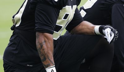 New Orleans Saints outside linebacker Victor Butler (90) takes a knee during an NFL football minicamp in Metairie, La., Thursday, May 29, 2014. Butler missed the entire 2013 due to a knee injury. (AP Photo/Bill Haber)