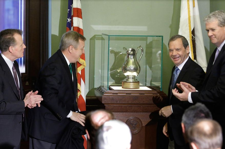 U.S. Sen. Dick Durbin, second from left, Illinois Speaker of the House Michael Madigan, D-Chicago, left, Illinois Senate President John Cullerton, D-Chicago, second from right, and Illinois House Minority Leader Jim Durkin, R-Western Springs, right, present a silver pitcher given to a 19th century Illinois senator that's been absent from the state for nearly 150 years to the Illinois State Capitol Friday, May  30, 2014, in Springfield Ill. (AP Photo/Seth Perlman)