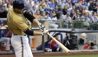 Milwaukee Brewers' Ryan Braun hits a two-run home run during the first inning of a baseball game against the Chicago Cubs, Friday, May 30, 2014, in Milwaukee. (AP Photo/Morry Gash)