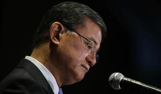 "Veterans Affairs Secretary Eric Shinseki pauses while speaking at a meeting of the National Coalition for Homeless Veterans, Friday, May 30, 2014, in Washington. President Barack Obama says he plans to have a ""serious conversation"" with Shinseki about whether he can stay in his job.  (AP Photo/Charles Dharapak)"