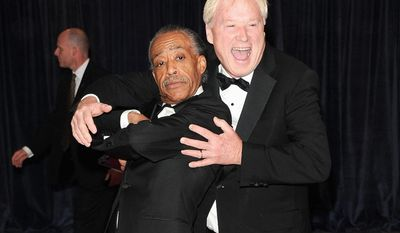 "** FILE ** ""Hardball"" host Chris Matthews bear hugs the Rev. Al Sharpton (left) at the at the Washington Hilton Hotel on April 27, 2013. (Associated Press)"