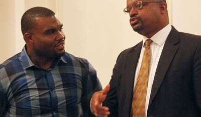 District Judge Robert L. Wilkins, right, talks with James Scott during the 22nd annual Black Expo corporate luncheon on Thursday, May 29, 2014 at Cornerstone Center for the Arts in Muncie, Ind. Scott, who works with the Youth Opportunity Center, said stories like Wilkins, who is a Muncie native, can be an inspiration to kids. (AP Photo/The Star Press, Corey Ohlenkamp)  NO SALES