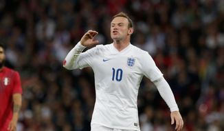 England's Wayne Rooney shouts instructions to a teammate during the international friendly soccer match between England and Peru at Wembley Stadium in London, Friday, May 30, 2014.  (AP Photo/Matt Dunham)
