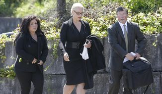 Jean Kasem, center, the wife of ailing radio personality Casey Kasem, walks with her daughter Liberty Kasem, left, and her attorney Steve Olsen, right, following a hearing in Kitsap County Superior Court, Friday, May 30, 2014 in Port Orchard, Wash. Jean Kasem was in court as part of an ongoing dispute with a stepdaughter who has been given authority to determine whether her father is receiving adequate medical care. Kasem and his wife have been staying with family friends in Washington state. (AP Photo/Ted S. Warren)