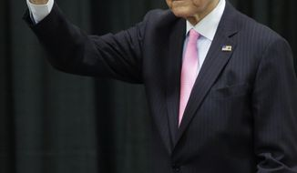 FILE - In this April 25, 2014, file photo, Sen. Orrin Hatch, R-Utah, waves before addressing a crowd during the Western Republican Leadership Conference, in Sandy, Utah. Hatch is apologizing for making political comments during a Memorial Day ceremony earlier this week. Hatch told KUTV-TV on Wednesday, May 28, that he didn't mean to offend anyone with the remarks at the Monday event in Woods Cross, which included discussion about the health care law and religious freedom.  (AP Photo/Rick Bowmer, File)