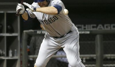 San Diego Padres' Chase Headley is hit by a pitch from Chicago White Sox starting pitcher John Danks during the fifth inning of an interleague baseball game Friday, May 30, 2014, in Chicago. (AP Photo/Charles Rex Arbogast)