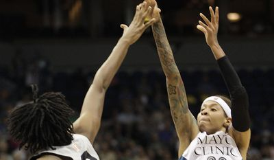Minnesota Lynx guard Seimone Augustus (33) goes up to shoot against San Antonio Stars center Kayla Alexander (40) in the first half of a WNBA basketball game on Friday, May 30, 2014, in Minneapolis. (AP Photo/Stacy Bengs)