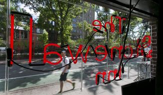 A neon sign fills the window of The Stonewall Inn, in New York's Greenwich Village, Thursday, May 29, 2014. The National Park Service is launching an initiative to make places and people of significance to the history of lesbian, gay, transgender and bisexual Americans part of the national narrative. Interior Secretary Sally Jewell plans to announce the initiative on Friday at New York's Stonewall Inn, which was made a national historic landmark in 2000.(AP Photo/Richard Drew)