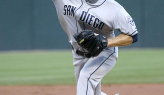San Diego Padres starting pitcher Ian Kennedy delivers during the first inning of an interleague baseball game against the Chicago White Sox on Friday, May 30, 2014, in Chicago. (AP Photo/Charles Rex Arbogast)